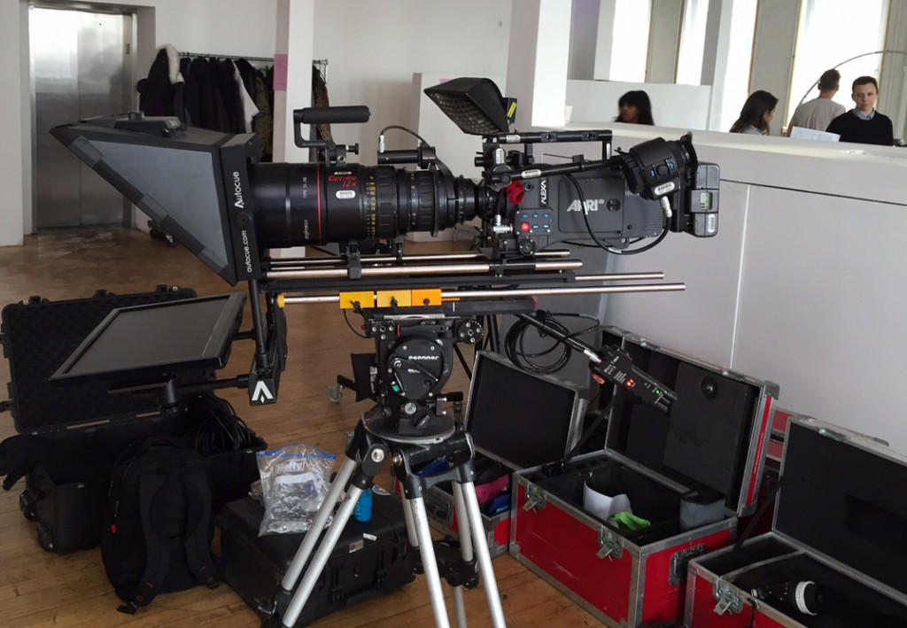 Side view Image of teleprompter on tripod with a very long lens.