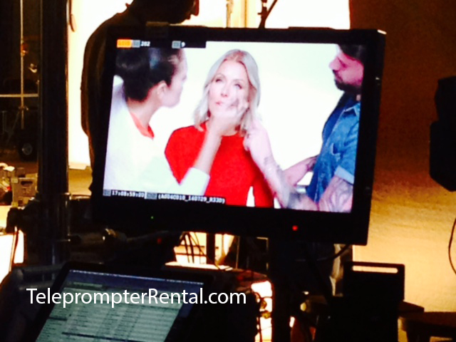 Colgate Comercial with screen shot of Kelly Ripa in red dress.