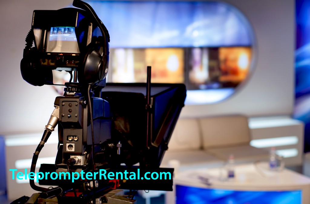 Image of bright TV studio with silhouette of TV camera on pedestal at stage left