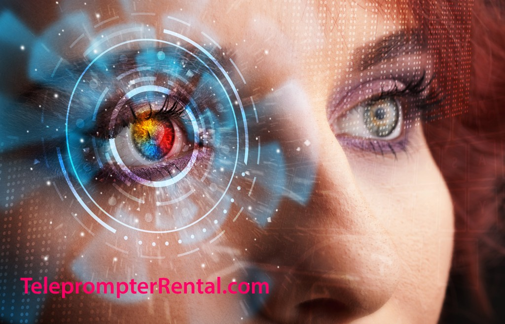 Close shot of beautiful redhead's eye with cyber imagery superimposed.