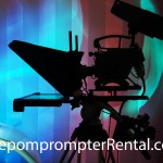 silhoutte of telepromoter against a multicolor background