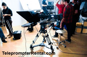 This is the Autocue Professional teleprompter mounted on a sturdy tripod in the American Movie Company studio in NYC