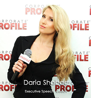 Daria Schabad with microphone - Executive Speech Coach