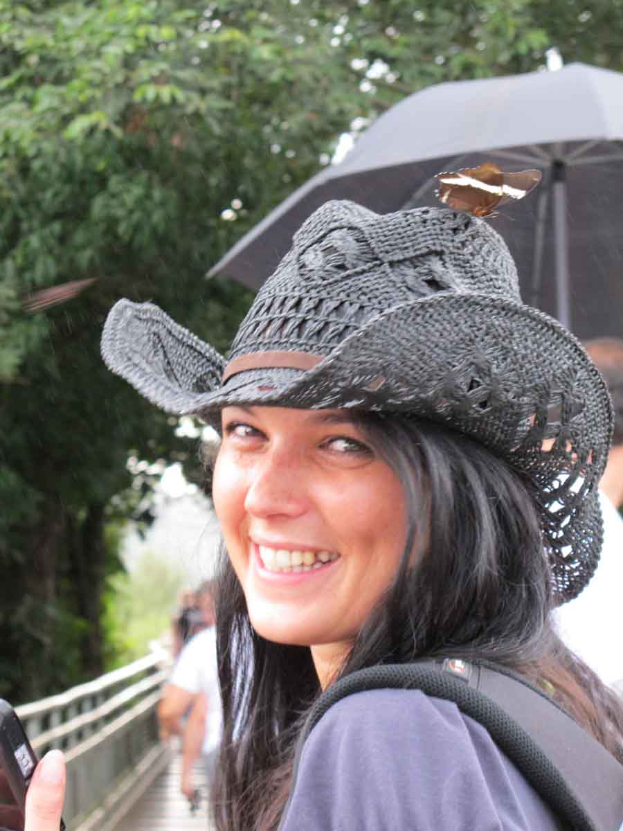 Beautiful girl with black hat = butterfly on it