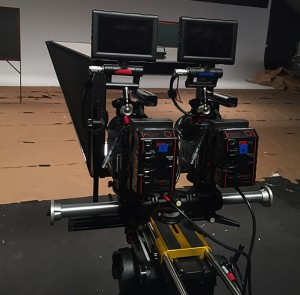 Two cameras both shooting through the same teleprompter