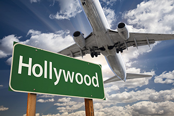 Green Hollywood highway sign - airplane above.