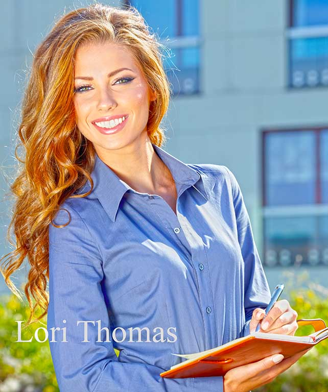 Lori Thomas, beautiful young woman, long red hair, writing in notebook.