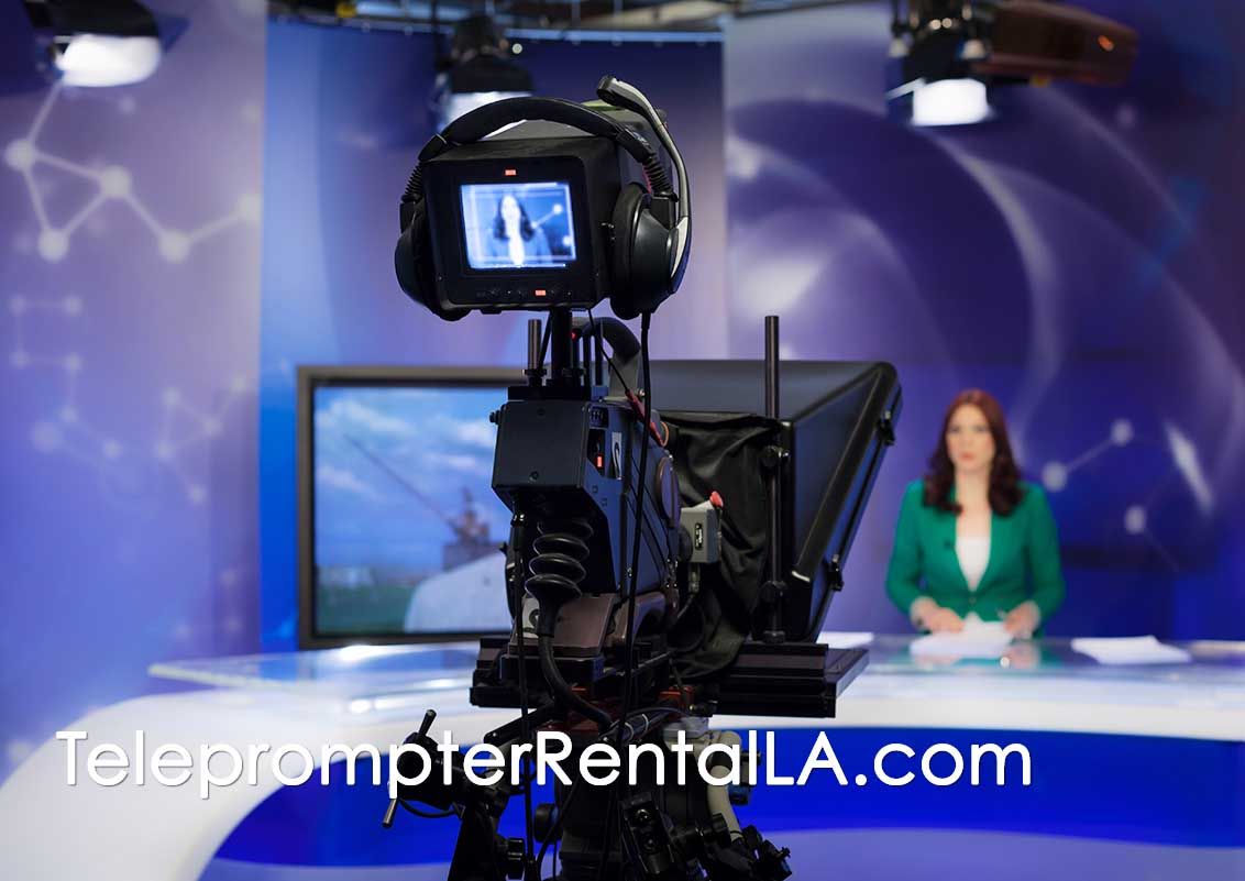 Studio - woman behind desk - TeleprompterRentalLA.com caption