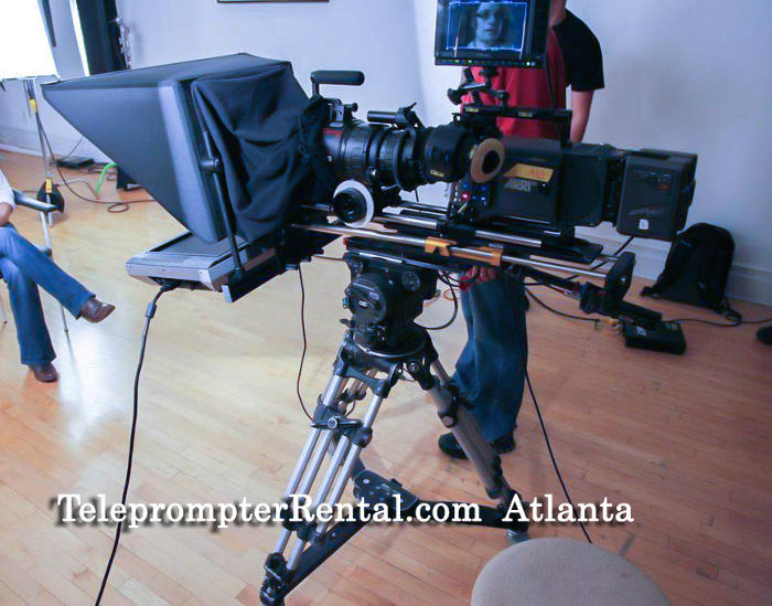 Teleprompter Rental Atlanta - teleprompter on tripod with camera and long lens.
