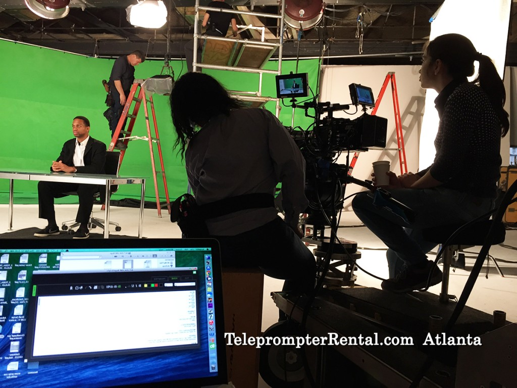Studio with green screen and teleprompter and camera in silhouette/