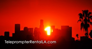 Amazing sunrise over downtown Los Angeles with caption TeleprompterREntalAL.com