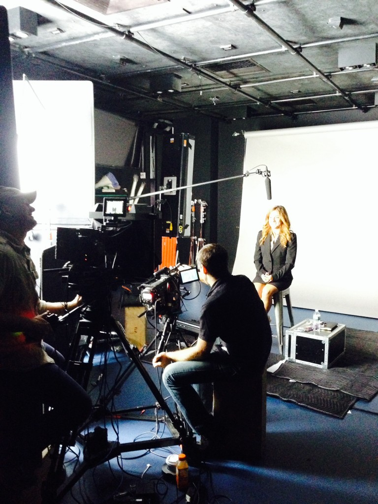 Teleprompter and crew with actress in studio. TeleprompterRental.com