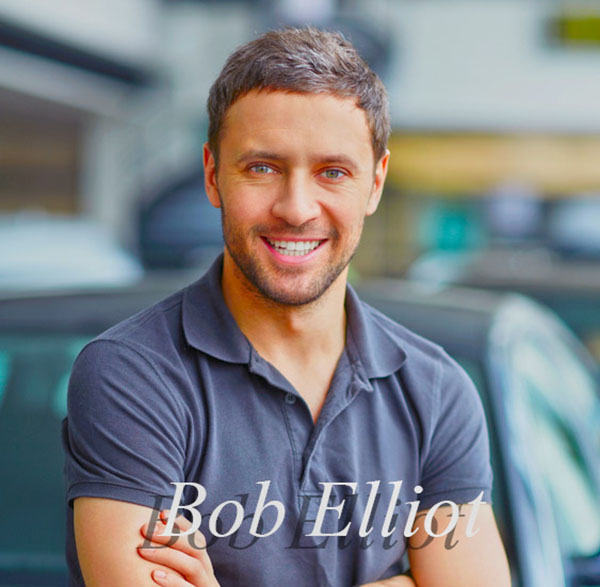 Bob Elliot, young man smiling in short sleeves.
