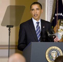 President Obama reads Presidential Teleprompter at Podium with seal