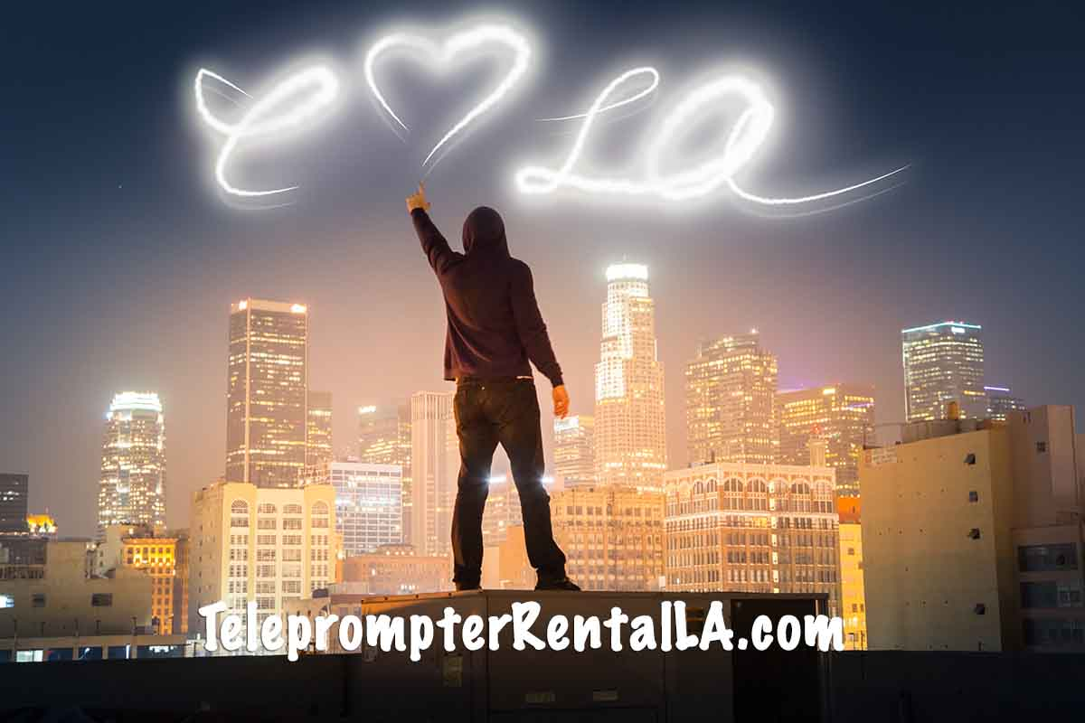 Graphic person writing I Love LA in the sky - Teleprompter Rental LA.com