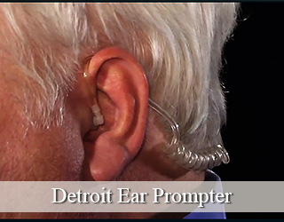Ear Prompter inserted into man's ear - close up