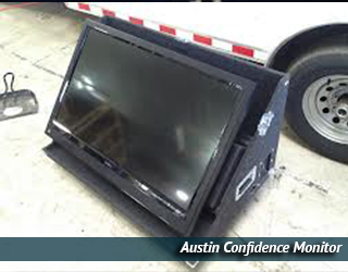 Confidence Monitor unit outdoors - car wheel in background - Austin