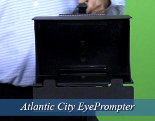 Man in blue shirt holding EyePrompter unit