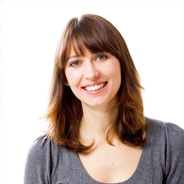 Smiling young woman, grey shirt
