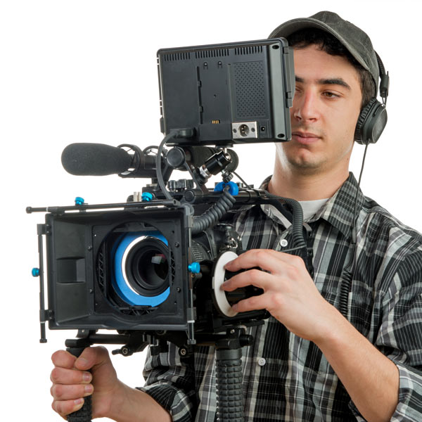 Xavier Torres, young man with headphones holding camera teleprompter