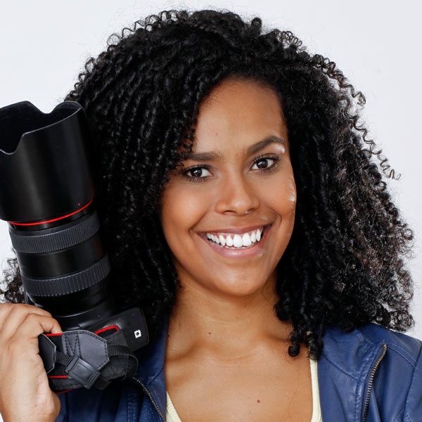 Tasha Lingfield - Producer - beautiful African American young woman holding huge camera