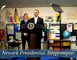 Presidential Teleprompter on very cluttered set - President Obama and man behind him.