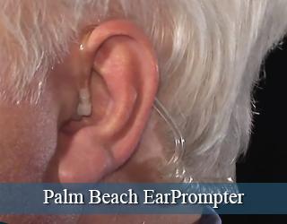 EarPrompter in man's ear - close up - Palm Beach