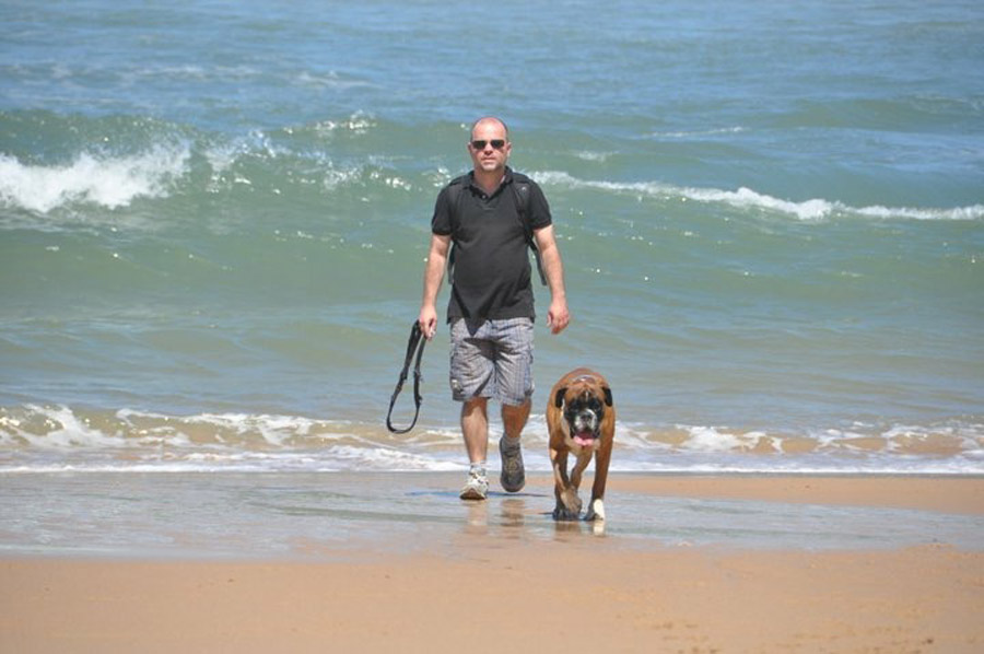 Pedro and dog Brutus on the beach