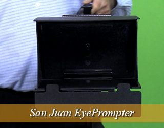 EyePrompter held by guy in blue shirt against green screen