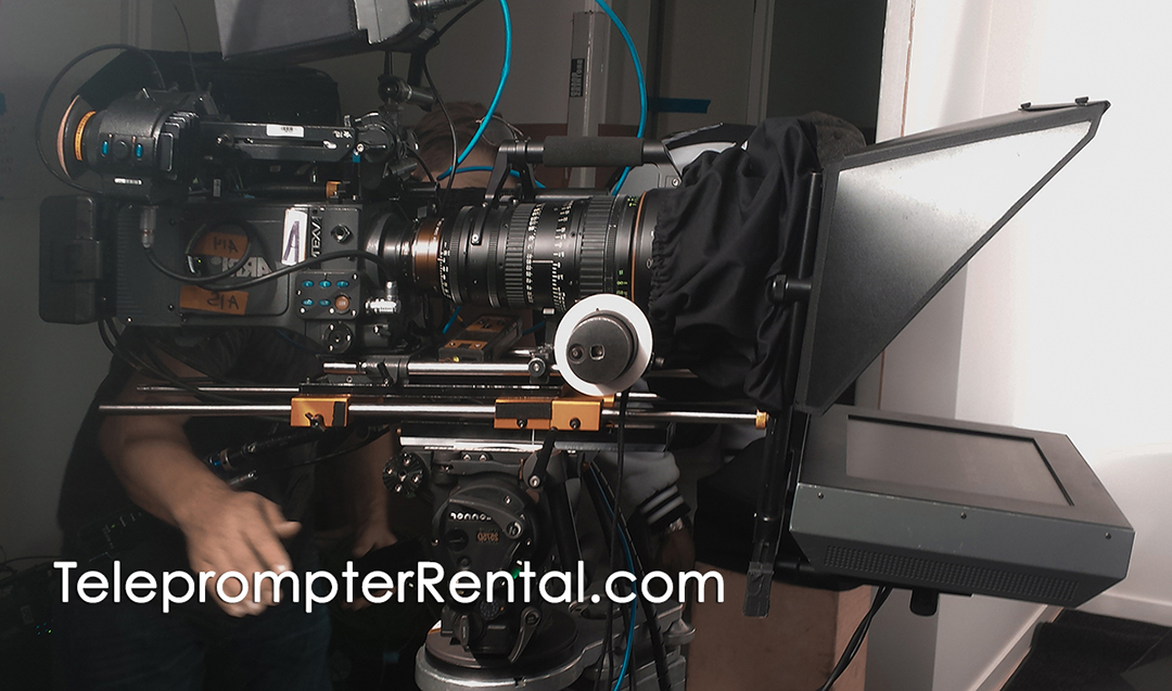 * Huge camera an long lens on AutoCue Gold Plate teleprompter with caption TeleprompterRental.com