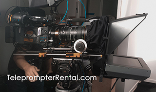 "Really big lens and camera on AutoCue telprompter with caption ""TeleprompterRental.com"